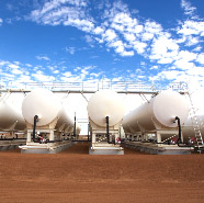Four white gas storage cylinders siting on the red earth of the Cooper Basin