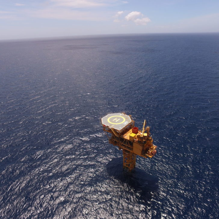 Image of an Kupe Offshore platform sitting alone and surrounded by a vast blue ocean